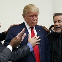 Pastors from the Las Vegas area pray with then Republican presidential candidate Donald Trump during a visit to the International Church of Las Vegas and International Christian Academy, Wednesday, Oct. 5, 2016, in Las Vegas, Nevada. (AP Photo/Evan Vucci)