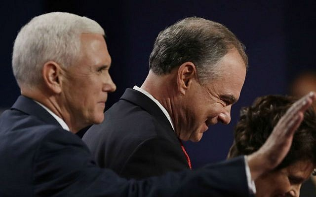 Democratic vice presidential nominee Sen. Tim Kaine leaves the stage with Republican vice-presidential nominee Gov. Mike Pence during the vice presidential debate at Longwood University in Farmville, Virginia, Tuesday, Oct. 4, 2016. (AP Photo/Patrick Semansky)
