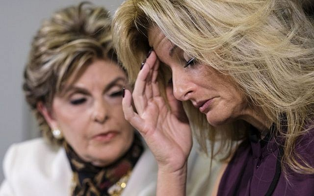 Summer Zervos reads a statement alongside her attorney Gloria Allred during a news conference in Los Angeles, October 14, 2016. (AP/Ringo H.W. Chiu)