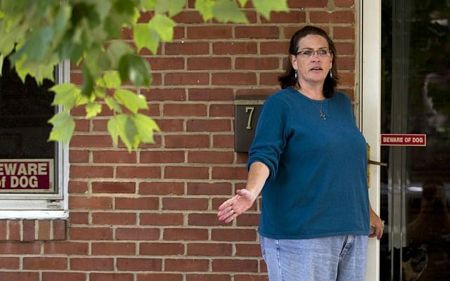 Debbie, the wife of NSA contractor Harold Thomas Martin III, talks to reporters outside of her home in Glen Burnie, Maryland, Wednesday, Oct. 5, 2016. (AP Photo/Jose Luis Magana)