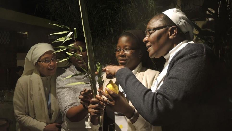 Catholic sisters in Nairobi on October 17, 2016, with the half-eaten lulav set. (Melanie Lidman/Times of Israel)