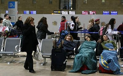 Passengers sleep at Ben Gurion International Airport, on March 19, 2008. (Anna Kaplan/ Flash90)
