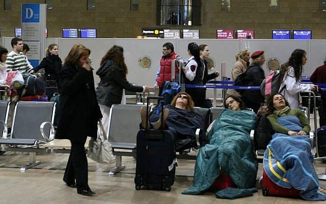 Passengers sleep at Ben Gurion International Airport, on March 19, 2008. (Anna Kaplan/ Flash90)