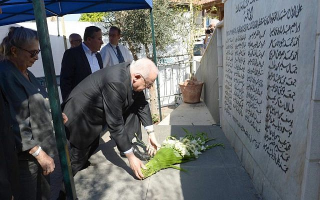 President Reuven Rivlin lays a wreath during a memorial ceremony to mark the 58th anniversary of the Kfar Qasem massacre on October 26, 2014. (Photo by Mark Neyman/GPO)