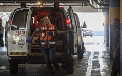 Paramedics exit an ambulance, illustrative (Hadas Parush/Flash90)