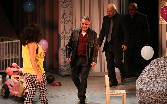 Israeli actor Moshe Ivgy (2L) seen with fellow actors at the end of a theater show in Tel Aviv, February 7, 2016.  Photo by Flash90