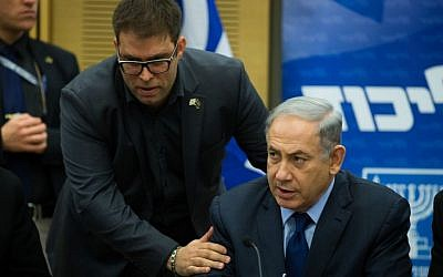 Prime minister Benjamin Netanyahu and leader of the Likud party speaks with MK Oren Hazan during a party meeting in the KInesset on February 8, 2016. (Yonatan Sindel/Flash90)