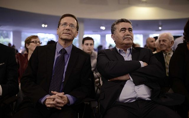 Leader of opposition, and leader of the Labor party, MK Isaac Herzog, left, seen at a party event with MK Amir Peretz, April 12, 2016. (Tomer Neuberg/FLASH90)