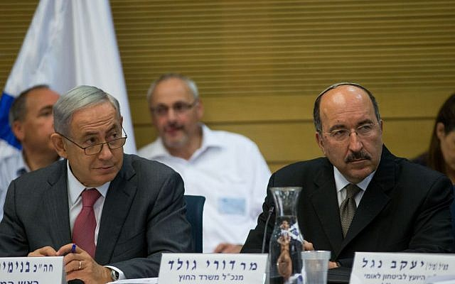 Benjamin Netanyahu, left, and Dore Gold attend a session of the State Control Committee at the Knesset on July 25, 2016. (Yonatan Sindel/Flash90)