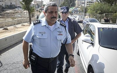 Israel Police Commissioner Roni Alsheikh arrives at the scene of a terror attack at the East Jerusalem neighborhood of Sheikh Jarrah on October 9, 2016. (Shlomi Cohen/Flash90)