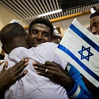 "Ethiopian families are reunited on October 9, 2016, as the first group of Ethiopian immigrants arrives at Ben Gurion airport since the government announced the ""end"" of Ethiopian aliyah in August 2013. (Miriam Alster/Flash90)"