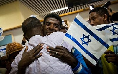 "Ethiopian families are reunited on October 9, 2016 as the first group of Ethiopian immigrants arrives at Ben Gurion airport since the government announced the ""end"" of Ethiopian aliyah in August 2013. (Miriam Alster/Flash90)"