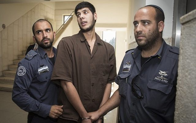 Muhammad Fuaz Ibrahim Julani, 22, from the Shuafat refugee camp in East Jerusalem is taken into the Jerusalem District Court for his indictment after being arrested for planning a large-scale terror attack in the city, on October 11, 2016. (Hadas Parush/Flash90)