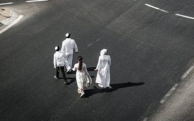 Orthodox Jews walk in the empty streets of Jerusalem on Yom Kippur, the holiest year in the Jewish calendar, on October 12 2016. (Photo by Sebi Berens/Flash 90)