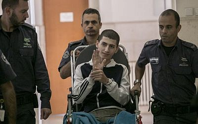 Ayman Kurd, 20, is escorted by Israeli prison officers at the District court in Jerusalem on October 20, 2016. (Yonatan Sindel/Flash90)