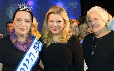 Sara Netanyahu (center) with the winner of a beauty pageant for Holocaust survivors, Anna Grinis, in Haifa on October 30, 2016. (Amos Ben Gershom/GPO)