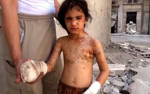 Six-year-old Amina in Aleppo blames Bashar Assad for killing her brothers (Screen capture: YouTube)