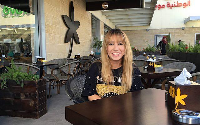 Hostess Nagla Aburous sitting at the Jasmine Cafe in Nablus before her shift, Sept. 18, 2016. (Andrew Tobin)