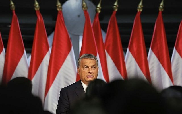 Hungarian Premier Viktor Orban looks at supporters before delivering a speech in Budapest, Hungary, Sunday, Oct. 2, 2016. (AP/Vadim Ghirda)