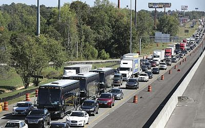 Traffic stacks up on I-75 North fleeing the coast and Hurricane Matthew on Thursday, Oct. 6, 2016, near McDonough. (Curtis Compton/Atlanta Journal-Constitution via AP)