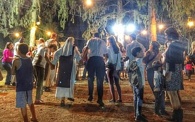 Revellers celebrate Simhat Torah at the Birkat Shalom synagogue in Kibbutz Gezer, October 23, 2016 (Sarah Tuttle-Singer)