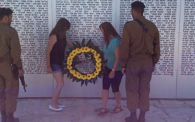 Heroes to Heroes women's trip participants lay a wreath at Latrun Armored Corps' Memorial, August 2016 (Courtesy)