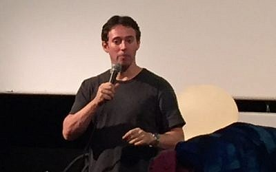 Avi Liberman takes questions at the Jerusalem premiere of his movie 'Comedy Road' on October 20, 2016 (Times of Israel)