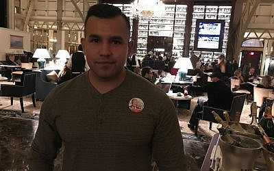 Trump supporter Albert Espinoza poses for a photograph while he visited Trump International hotel in Washington, DC (Eric Cortellessa/Times of Israel)