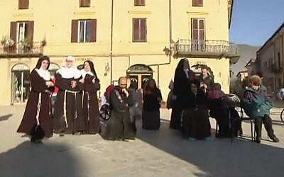 Priests and nuns flee their church in Norcia, Italy on October 30, 2016, after a powerful earthquake with a preliminary magnitude of 6.6 rocked central and southern Italy. (Screenshot, Sky Italia via AP)