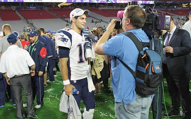 A reporter uses LiveU technology at the Super Bowl in 2015 (Courtesy)