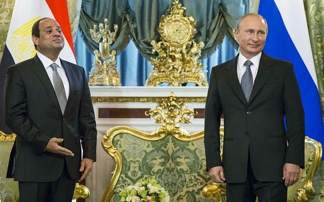 In this Wednesday, Aug. 26, 2015 file photo, Russian President Vladimir Putin, right, and Egyptian President Abdel-Fattah el-Sissi wait for their delegations during their meeting in the Kremlin, Moscow, Russia. (AP Photo/Alexander Zemlianichenko, Pool, File)