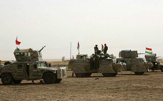 A Kurdish peshmerga convoy drives towards the front line in Khazer, about 30 kilometers (19 miles) east of Mosul, Iraq, Monday, Oct. 17, 2016. (AP Photo)