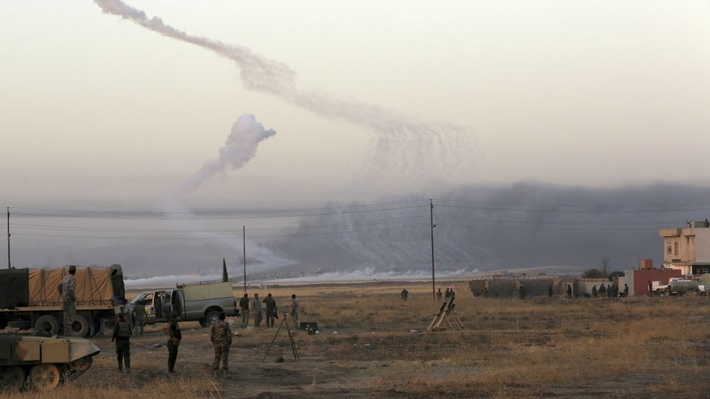 Smoke rises in nearby Mosul as Iraq's elite counterterrorism forces advance towards the city, Iraq, Thursday, Oct. 20, 2016. (AP Photo/Khalid Mohammed)
