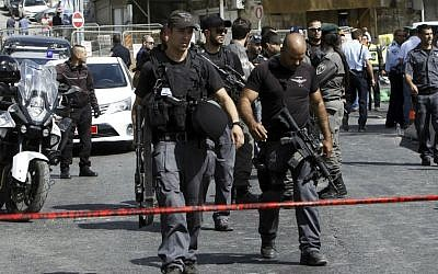 Israeli police secure the scene where a car driven by a Palestinian terrorist was intercepted by the police and the gunman shot dead in Jerusalem Sunday, Oct. 9, 2016. (AP Photo/Mahmoud Illean)