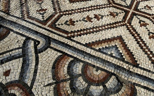 A portion of a 7th century, 827 square meter (8,900 square ft) mosaic is on display ahead of the opening ceremony at the Islamic archaeological site of Hisham Palace, in the West Bank city of Jericho, Thursday, Oct. 20, 2016. (AP Photo/Nasser Nasser)