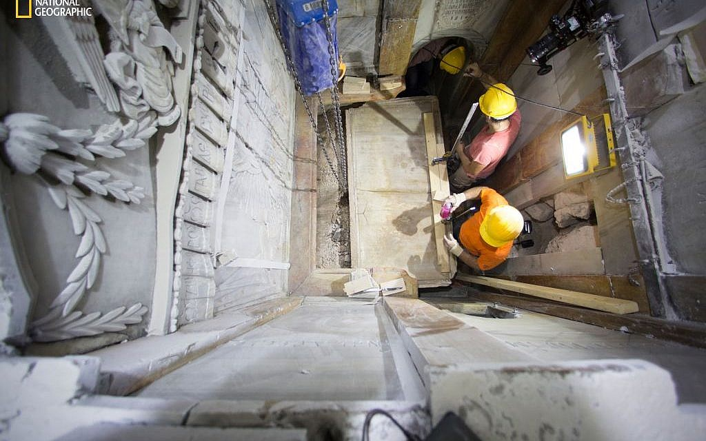 This Wednesday Oct. 26, 2016 photo shows the moment workers remove the top marble layer of the tomb said to be of Jesus, in the Church of Holy Sepulchre in Jerusalem. A restoration team has peeled away a marble layer for the first time in centuries in an effort to reach what it believes is the original rock surface where Jesus' body was laid. (Dusan Vranic/National Geographic via AP)