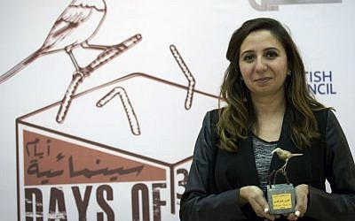 In this Thursday Oct. 20, 2016 photo, Palestinian producer May Odeh holds the Sunbird Short Film Award trophy for the film entitled 'Izriqaq (Blued),' during the Days of Cinema awards ceremony, in the West Bank city of Ramallah. (Nasser Nasser/AP)