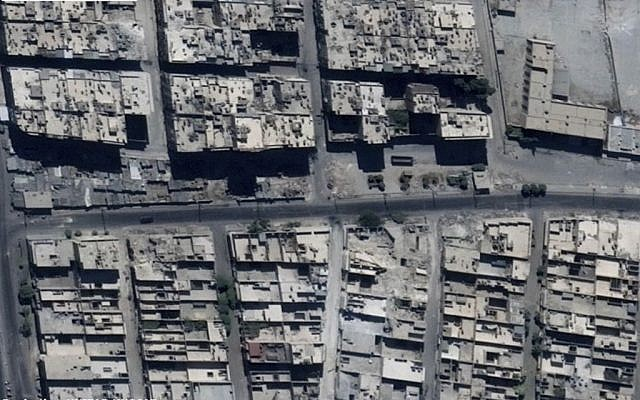 This satellite images released by the United Nations, shows the Sha'ar district of Aleppo, Syria, September 18, 2016, before it was bombed with strikes leaving craters in a road. (US Department of State, Humanitarian Information Unit, UNITAR-UNOSAT via AP)