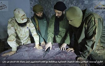 Abu Mohammed al-Golani (center) the leader of al-Qaeda linked insurgent group Fatah al-Sham Front, is seen in this picture posted by the group discussing battlefield details with field commanders. (Militant UGC via AP)