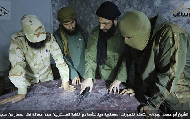 Abu Mohammed al-Golani (center), the leader of al-Qaeda-linked insurgent group Fatah al-Sham Front, is seen in this picture posted by the group discussing battlefield details with field commanders. (Militant UGC via AP)