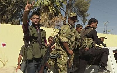 Members of a Turkish-backed Syrian opposition force patrol in Dabiq, Syria, Sunday, Oct. 16, 2016. (Screen capture: Qasioun News Agency via AP)