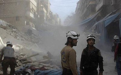 In this picture provided by the Syrian Civil Defense group known as the White Helmets, Syrian Civil Defense workers search through the rubble in rebel-held eastern Aleppo, Syria, Wednesday, October 12, 2016. (Syrian Civil Defense- White Helmets via AP)