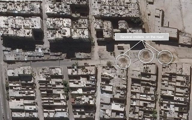 This satellite images released by the United Nations, shows road damage and craters, in the Sha'ar district of Aleppo, Syria, Sept. 25, 2016.  (US Department of State, Humanitarian Information Unit, UNITAR-UNOSAT via AP)