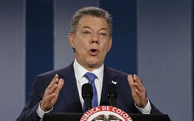 In this Wednesday, Oct. 4, 2016 file photo Colombia's President Juan Manuel Santos delivers a statement to the press after meeting with former President Alvaro Uribe and other opposition leaders at the presidential palace in Bogota, Colombia. (AP Photo/Fernando Vergara, File)