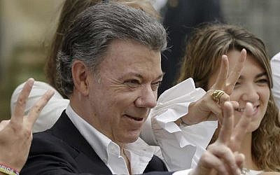 In this Sunday, Oct. 2, 2016 photo Colombia's President Juan Manuel Santos makes the victory sign after voting in a referendum to decide whether or not to support the peace deal he signed with rebels of the Revolutionary Armed Forces of Colombia, FARC, in Bogota, Colombia. Santos has won the Nobel Peace Prize, it was announced on Friday Oct. 7, 2016. (AP Photo/Ricardo Mazalan, File)