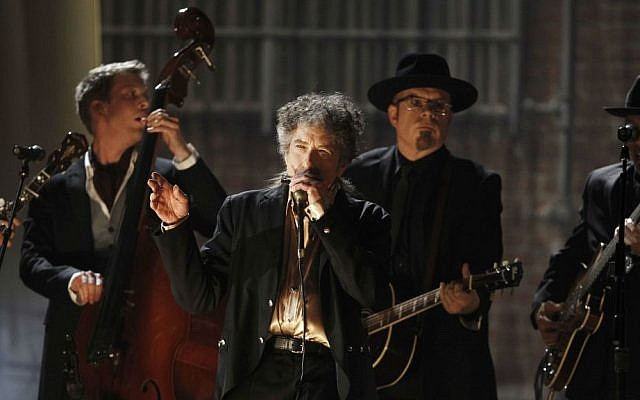 Illustrative: In this February 13, 2011, file photo, Bob Dylan, center, performs at the 53rd annual Grammy Awards in Los Angeles. (AP Photo/Matt Sayles, File)