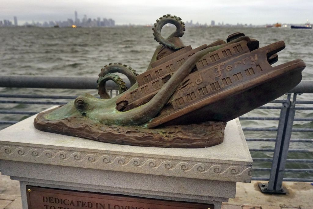 In this Sept. 29, 2016 photo, the cast bronze faux monument by artist Joseph Reginella, dedicated to the memory of the victims of the steam ferry Cornelius G. Kolff, is shown in the Staten Island borough of New York. (AP Photo/ Ula Ilnytzky )