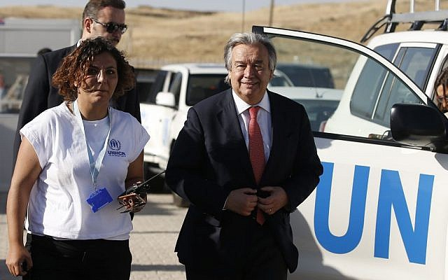 Antonio Guterres, at the time, UN High Commissioner for Refugees, right, arrives for a visit at the Midyat refugee camp in Mardin, southeastern Turkey, near the Syrian border, June 20, 2015. (AP/Emrah Gurel)