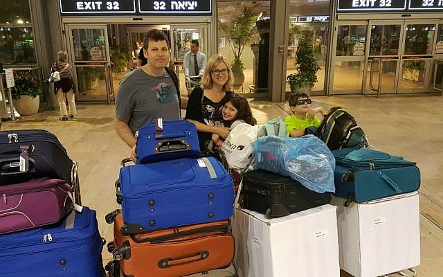 Zivan and Carmit Ori, relocating to the US, on the day of their departure from Israel with their 2 children, July 2016 (Courtesy)