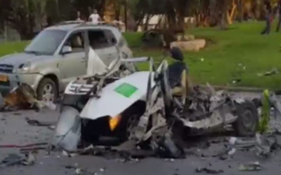 The remains of a car that was blown up on Tel Aviv's La Guardia street on October 16, 2016. One man was killed in what was said by police to be a gangland killing (Channel 2 screenshot)